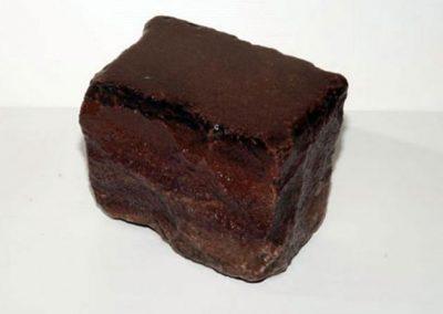 Grés ancien 14 x 20 x 14 cm noir Faconné par l'usure.