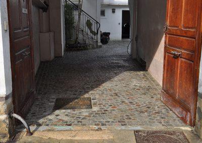 Réalisation d'une cours en pavés granit anciens mélange 10x9x8cm pose en forme de rosace - Chantilly Oise